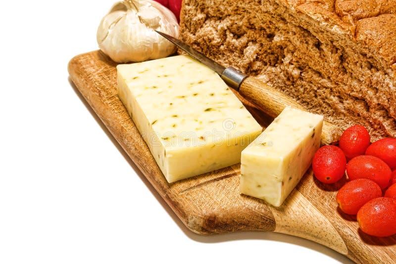 Queso del país y comida del bocado del pan fotografía de archivo