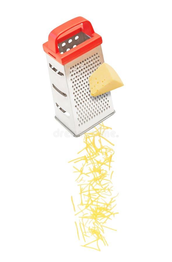 Queso rallado que cae del rallador imagen de archivo libre de regalías