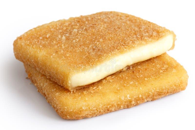 Quesos fritos de oro cuadrados aislados imagen de archivo libre de regalías