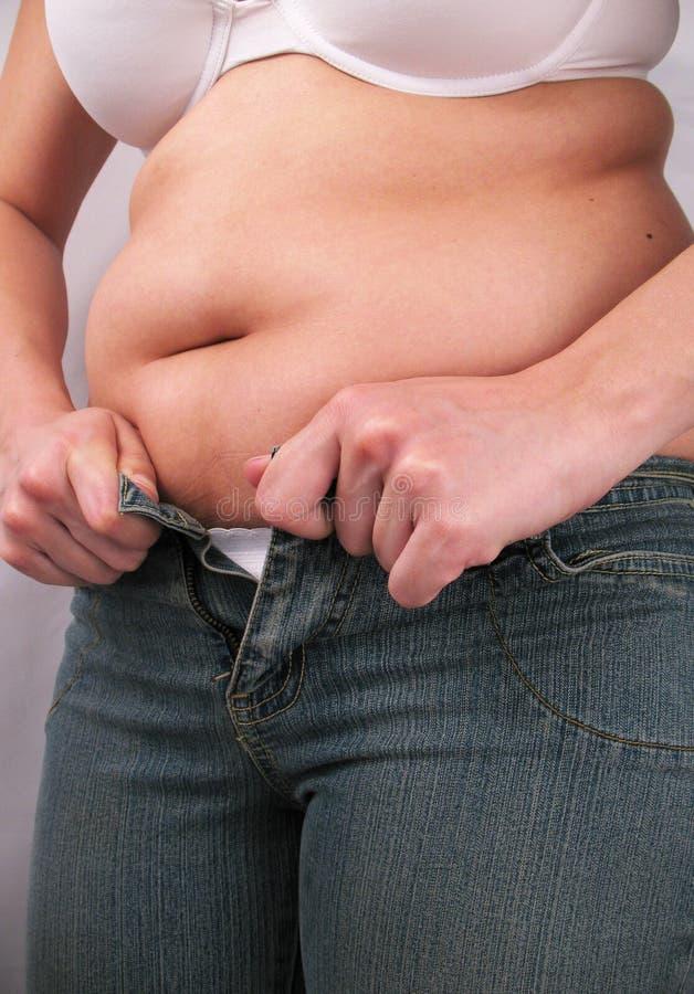 Questi jeans non si adatteranno più fotografia stock libera da diritti