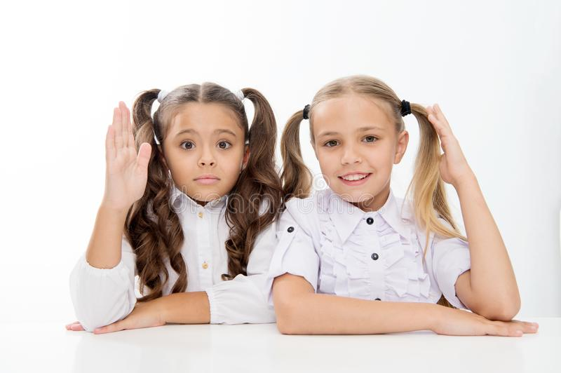 Question and answer. little school girls know answer to question. i know. little school girls with raised hands. stock photos