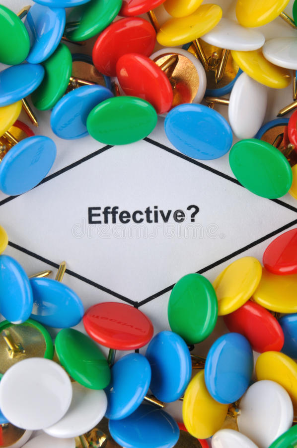 Question about effectiveness. Colorful drawing pin is surrounding important message which have clear meaning, a question about effectiveness stock photography