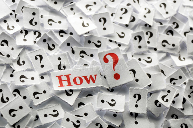 Question how. How question marks on white papers -hard light stock photography
