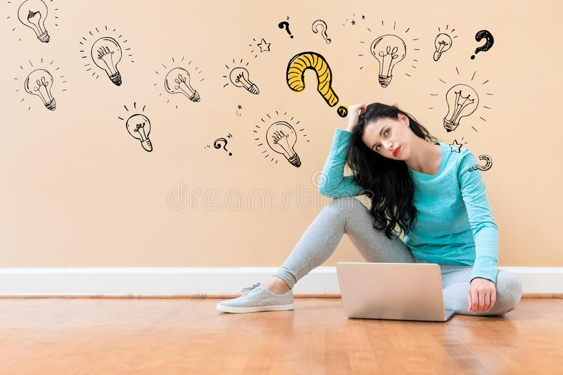 Question with light bulbs with woman using a laptop stock illustration