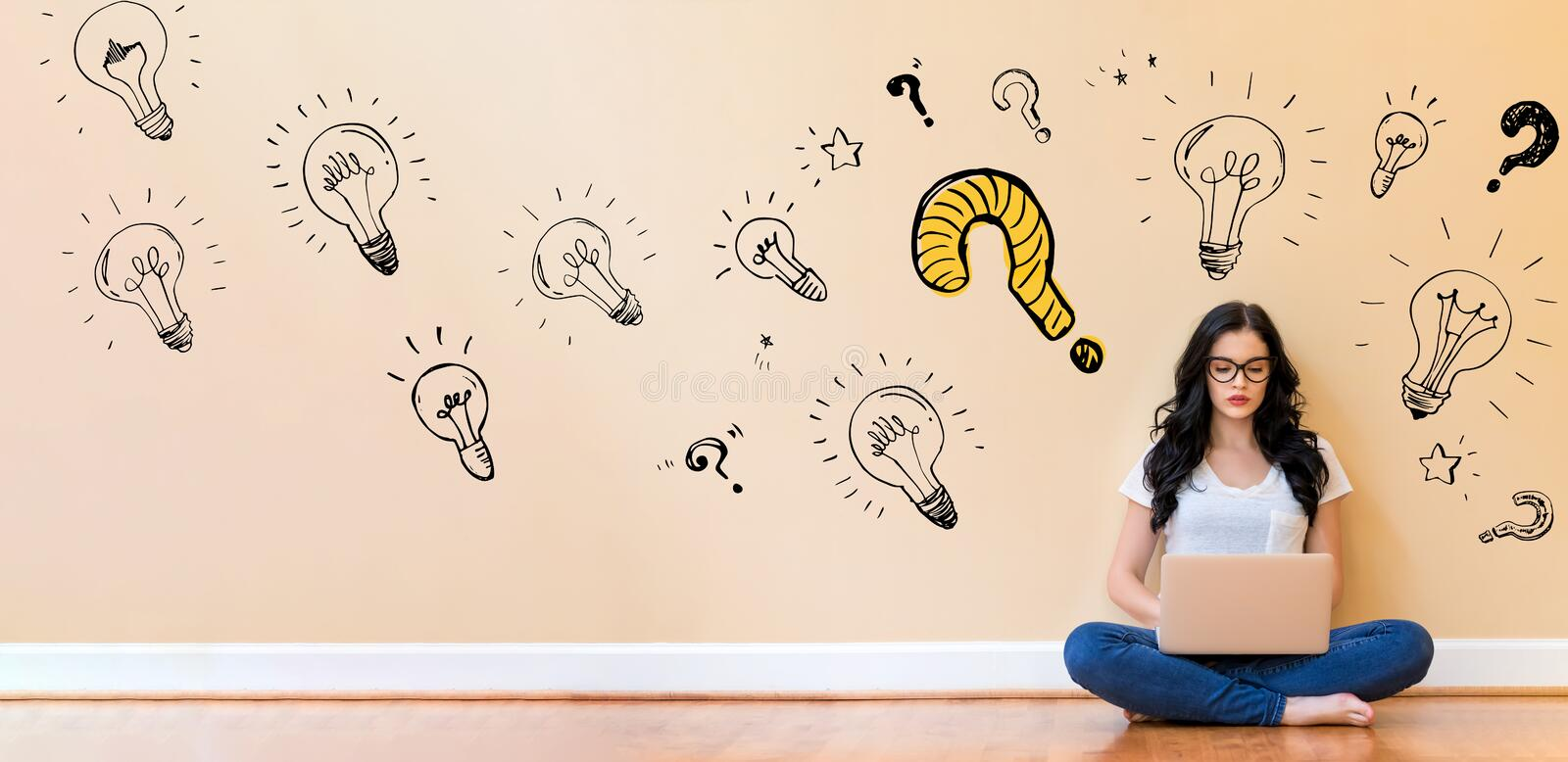 Question with light bulbs with woman using a laptop stock photos