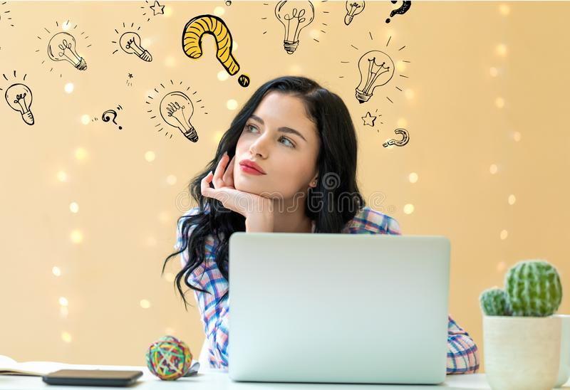 Question with light bulbs with young woman royalty free stock photography