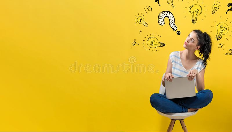 Question with light bulbs with woman using a laptop. Question with light bulbs with young woman using a laptop computer stock photos