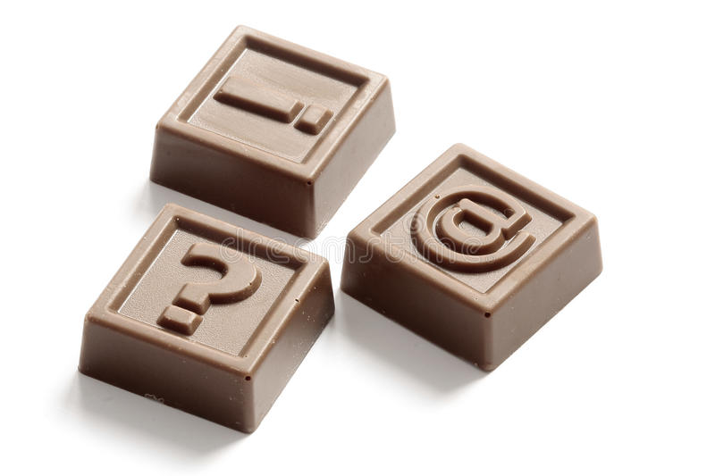 Question mark, exclamation point and at. Made of chocolate stock image