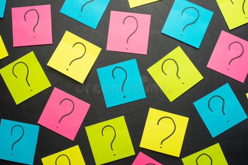 Question mark heap on table concept for confusion, question or solution royalty free stock photography