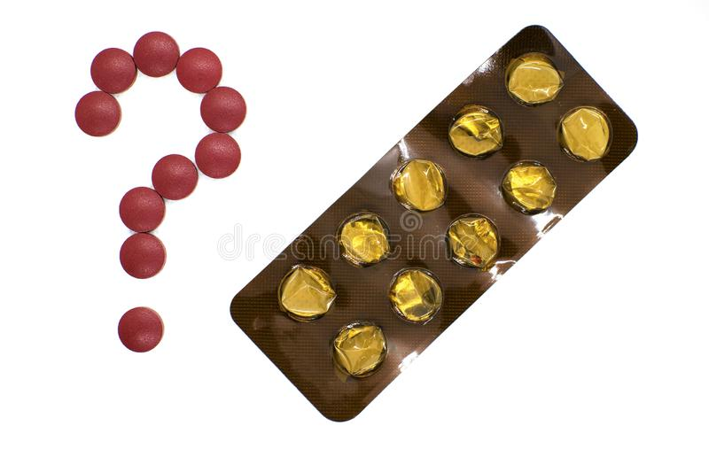 Question mark lined with pills and blank blister on white background. The concept of medical treatment. Treatment of the liver, various diseases. Methods of royalty free stock image