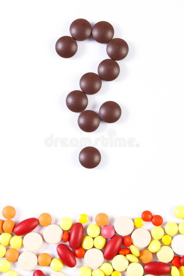 Question mark made of medical pills and tablets on white background, health care concept royalty free stock photos