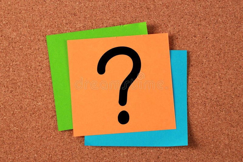 Question Mark Note. Pasted on cork board royalty free stock images