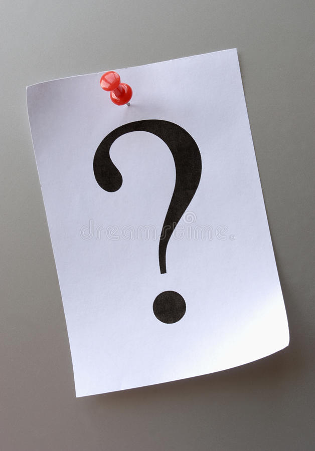 Question mark on a piece of paper stock photography
