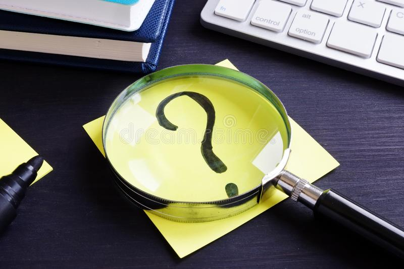 Question mark on a piece of paper. Problem solving. stock photo