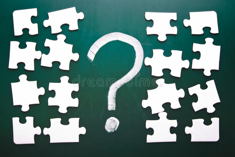 Question mark and puzzle pieces royalty free stock image