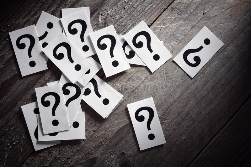 Question mark. Heap on table concept for confusion, question or solution royalty free stock photo