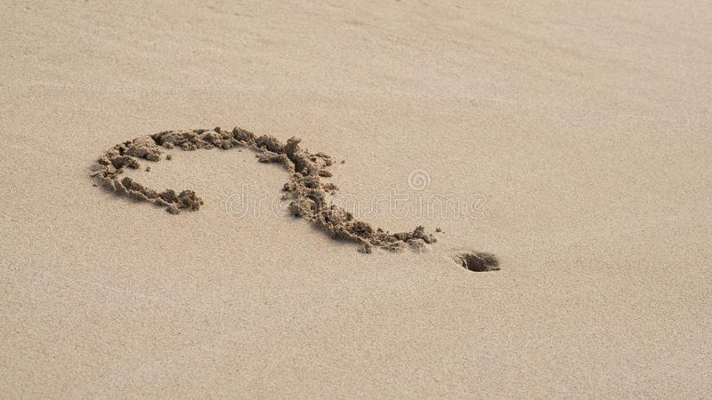 Question-mark in the sand. Question mark in the sand stock images