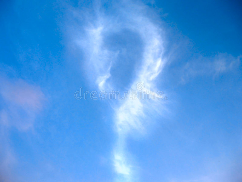 Question mark in sky. Question mark created by easy clouds in the blue sky stock image