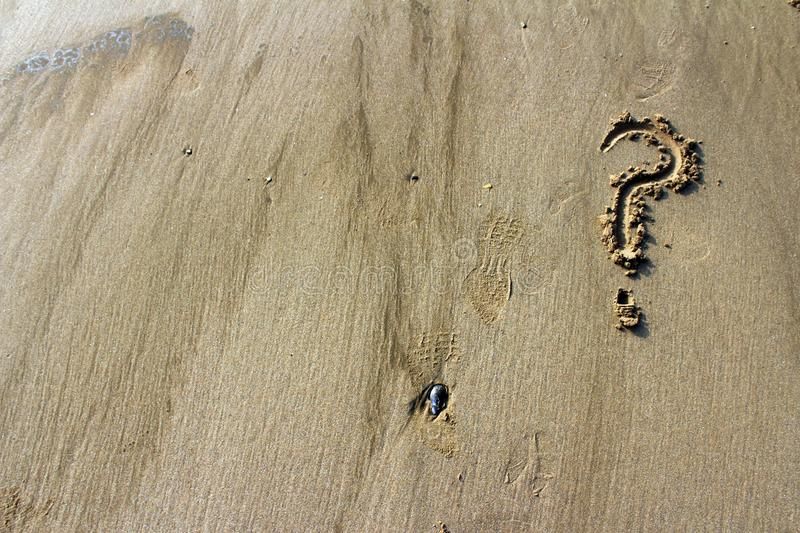 Question mark. Written in the sand stock photography