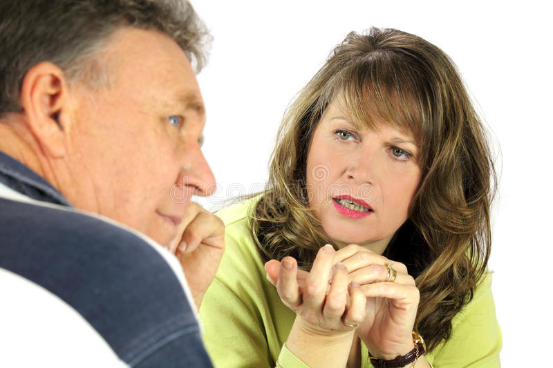 Questioning Couple. Man looking away while being questioned by his spouse royalty free stock images