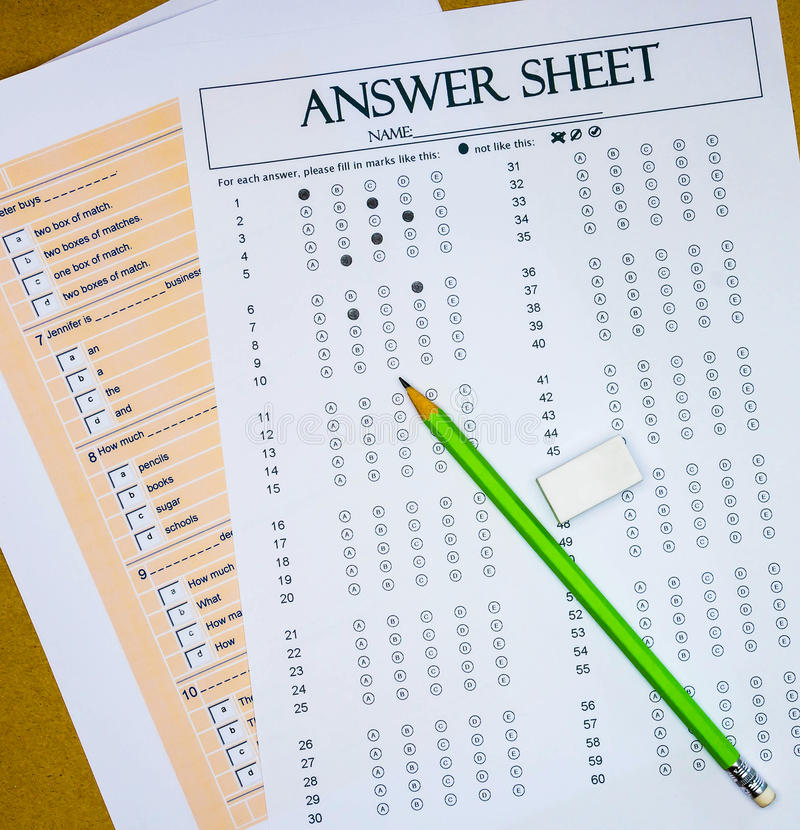 Questions and answer sheet. Top view of questions and answer sheet for English test on table stock photos