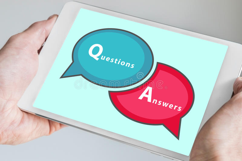 Questions and Answers Q&A session concept with hands holding modern tablet or smartphone to be used as slide background royalty free stock photography
