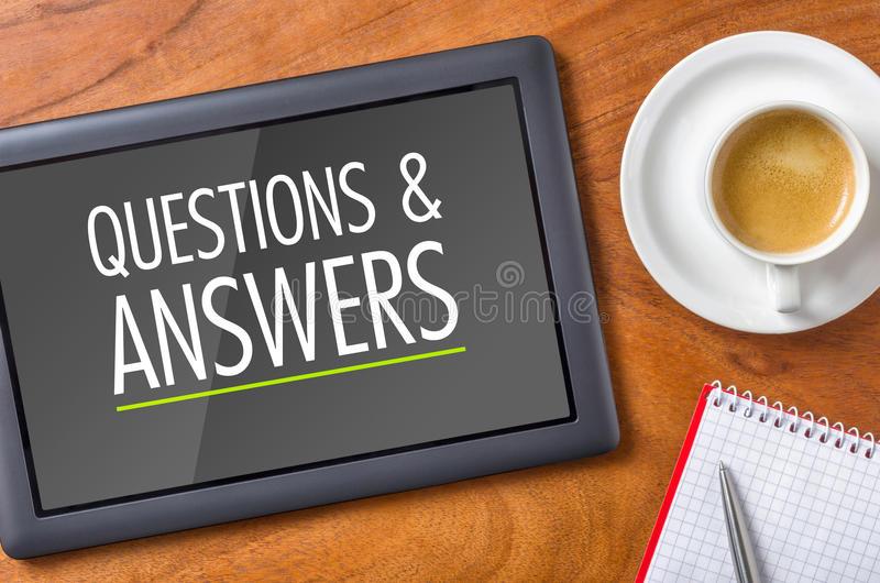 Questions and Answers. Tablet on a desk - Questions and Answers