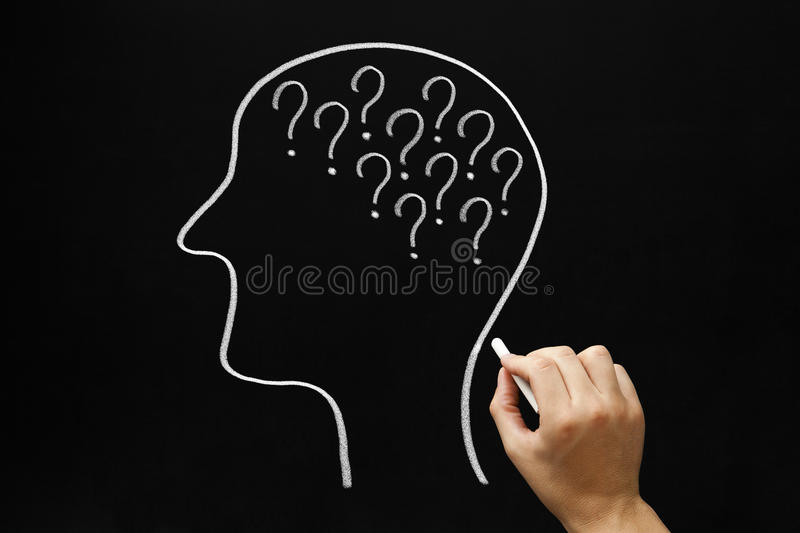 Questions Concept Blackboard. Hand drawing Human head and many question marks with white chalk on blackboard stock images
