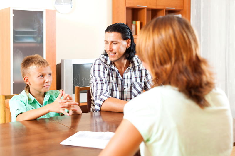 Questions of a social worker. Son and father answer questions of a social worker royalty free stock photography