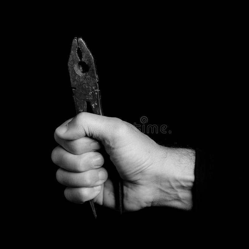 Quetschwalze - Werkzeuge in einer Mann ` s Hand stockfoto