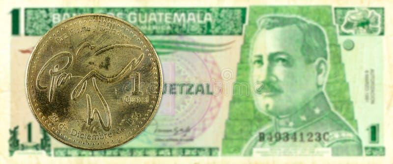 1 quetzal coin against 1 guatemalan quetzal bank note obverse. Specimen royalty free stock photos