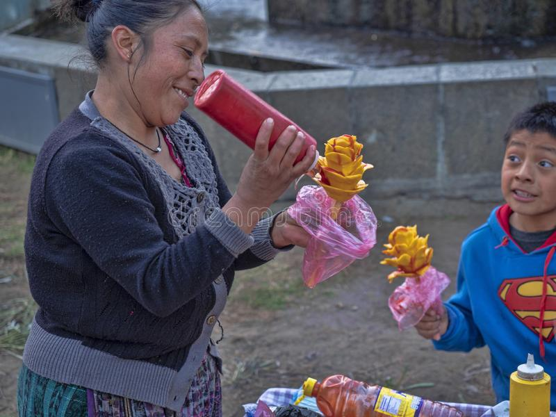 Woman decorating mango, Quetzaltenango, Guatemala stock image