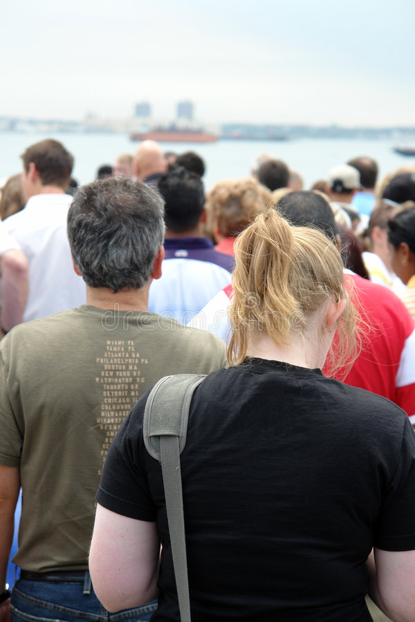 Queue. Waiting line with a woman and a man in front royalty free stock images