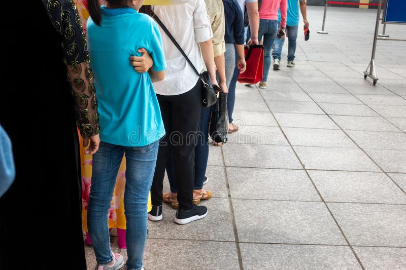 Queue of Asian people wait in line in urban street royalty free stock photos