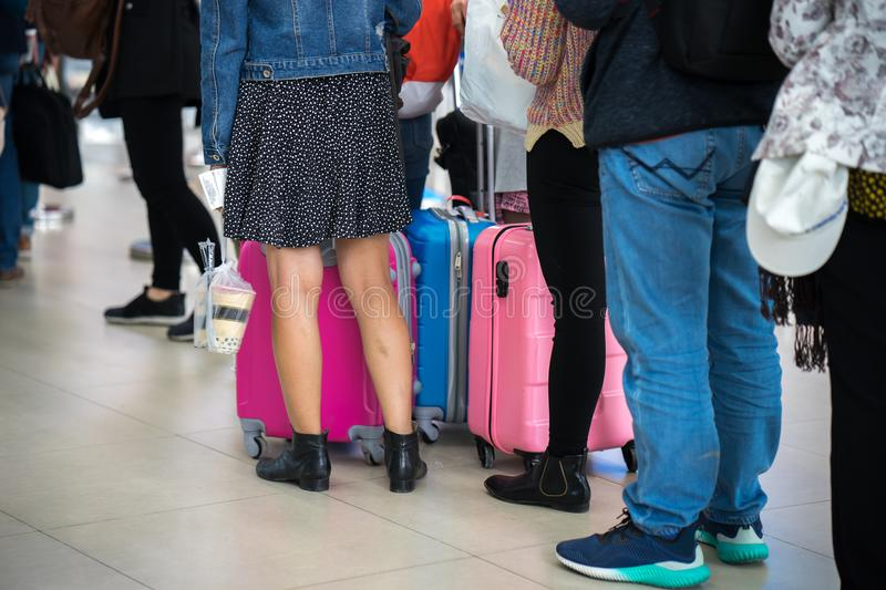 Queue of Asian people waiting at boarding gate at airport. Closeup. royalty free stock images
