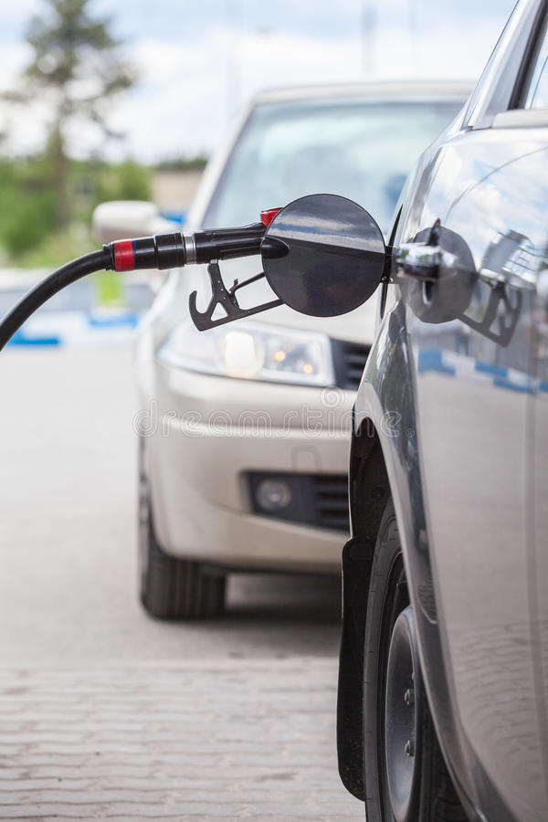 Queue of cars at a petrol station stock images