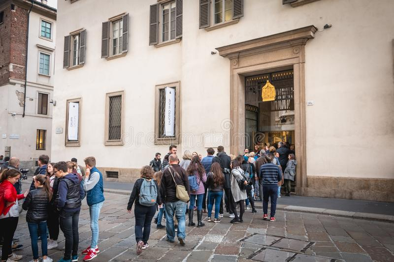 Queue of customer come to dedicate a book in the Duomo shop in Milan, Italy. Milan, Italy - November 2, 2017: Queue of customer come to dedicate a book in the stock images