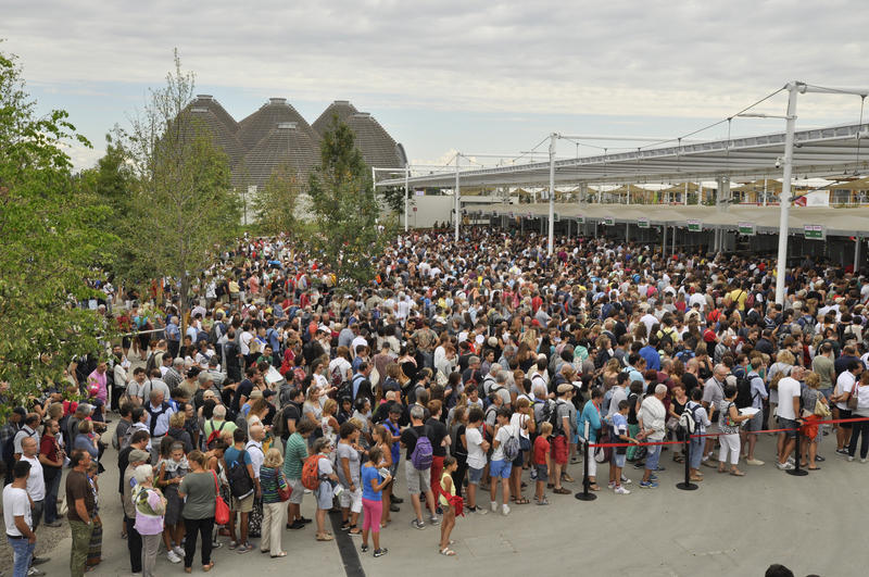 Queue at entrance of EXPO. Location: Milan, Italy. Date: August 20 2015. Content: Long queue of visitors waiting in the morning at entrance of EXPO in Milan stock photos