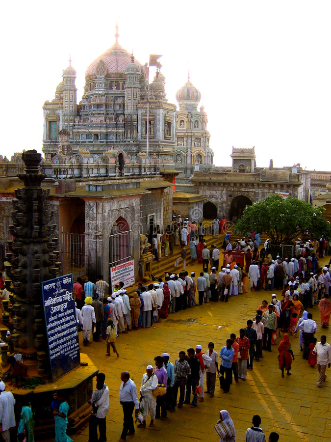 Queues of devotion. Pilgrims line up in long queues for worshipping their deity stock photo