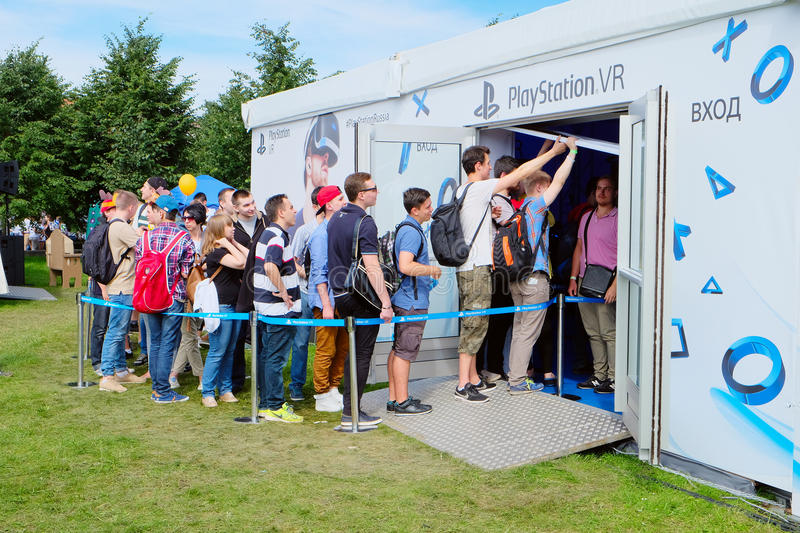 The queues of young people in front of pavilion from SONY waiting play ps4 the new generation stock photography