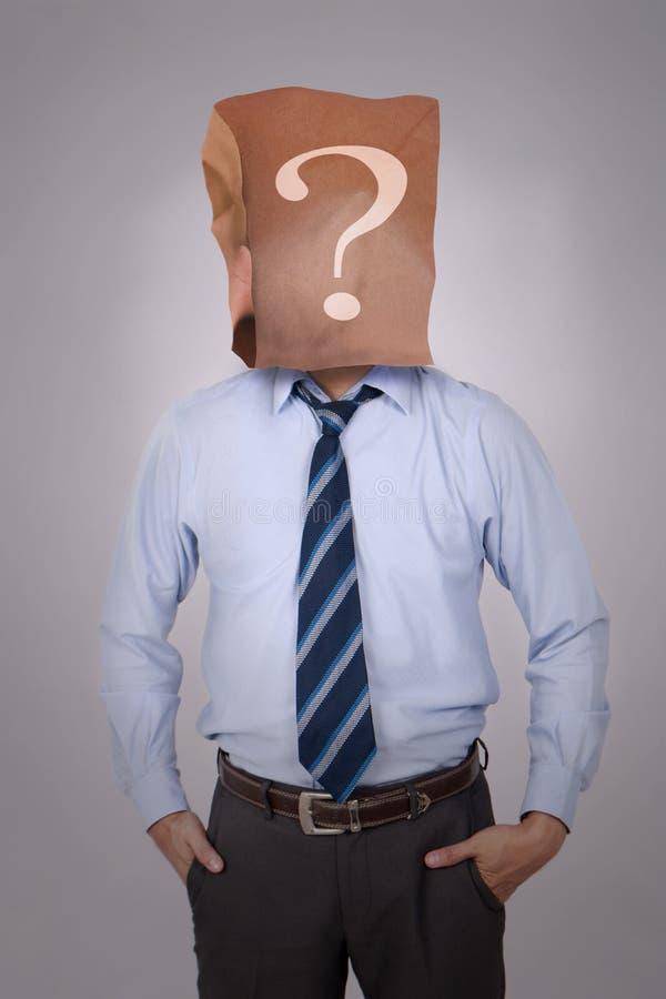 Qui sont vous, homme d'affaires dans le déguisement image libre de droits