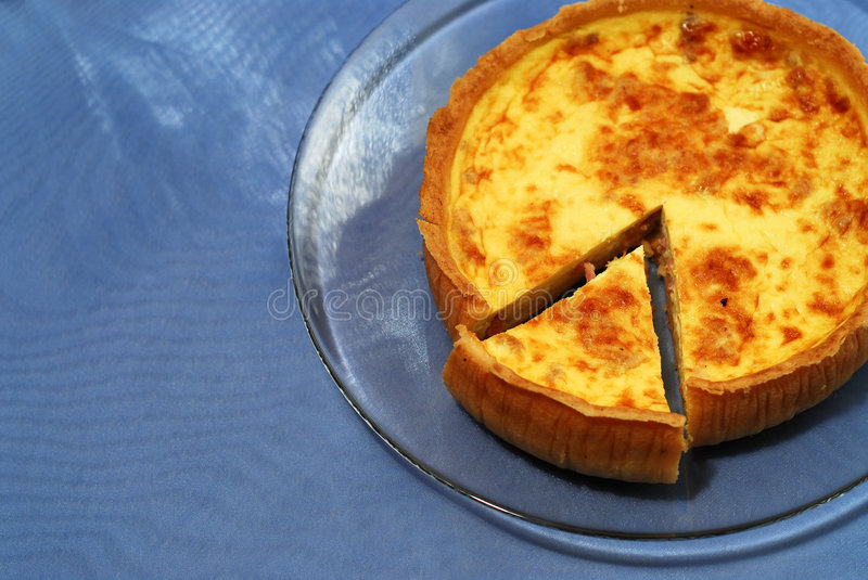 Quiche on blue stock photography