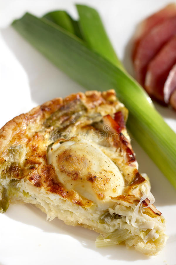 Quiche and leek on a plate royalty free stock images