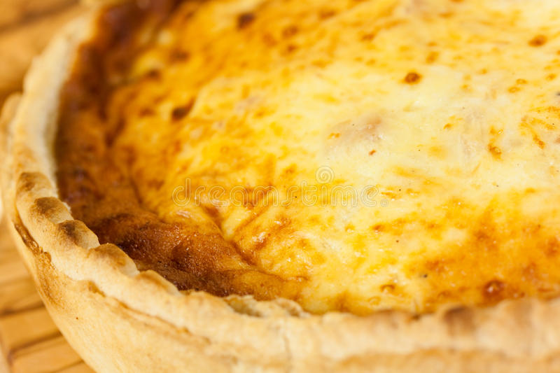 Quiche Lorraine on the cutting board royalty free stock photos