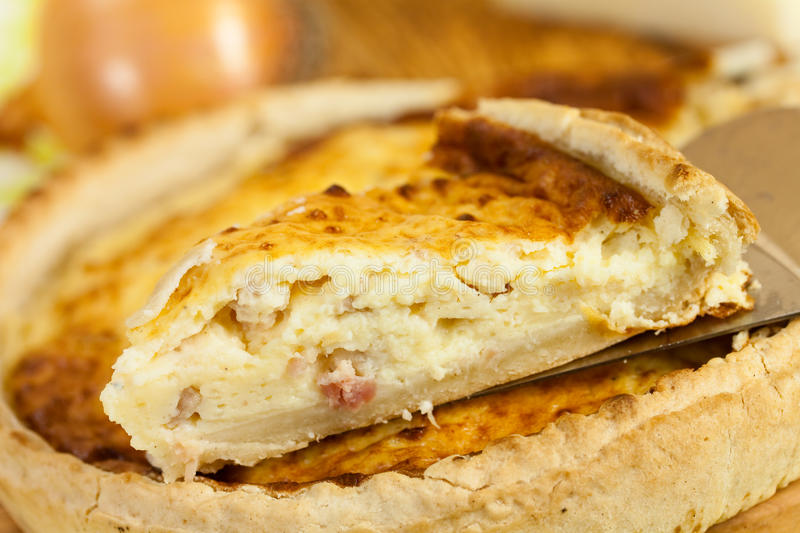 Quiche Lorraine on the cutting board stock image
