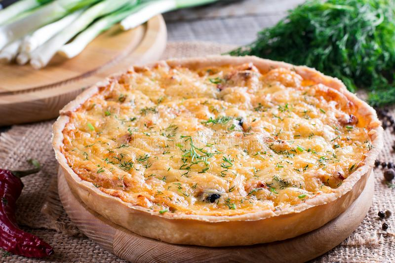 Quiche lorraine - pie with cheese, ham and leek royalty free stock photo