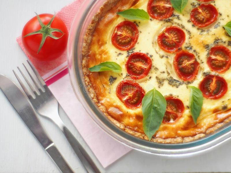 Quiche Lorraine. Traditional French savory pie. Homemade tart with cherry tomato and leek. Top view. stock photos