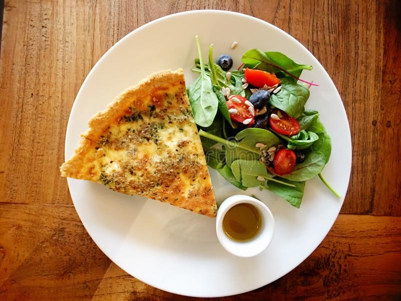 Quiche with salad stock photography