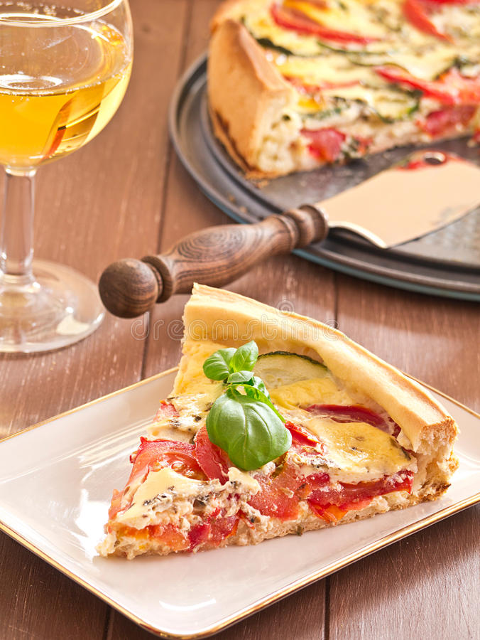 Quiche with tomatoes and zucchini stock photography