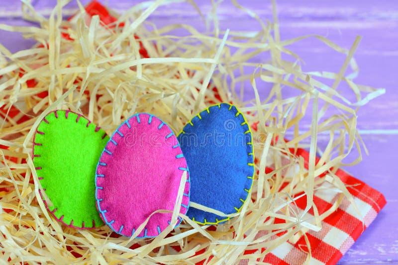 Stuffed felt eggs. Vivid felt eggs decorations. Happy Easter greeting card. Easter symbols background. Easter table decorations. Quick Easter decoration ideas royalty free stock photos